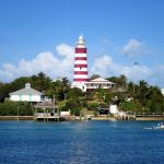 A lighthouse with red and white stripes in The Bahamas