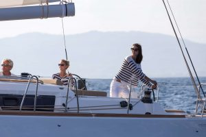 Two women and a man on the deck of a yacht