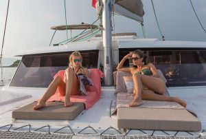 Two women relaxing on the bow of a yacht