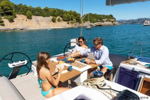 A family eating lunch on a yacht