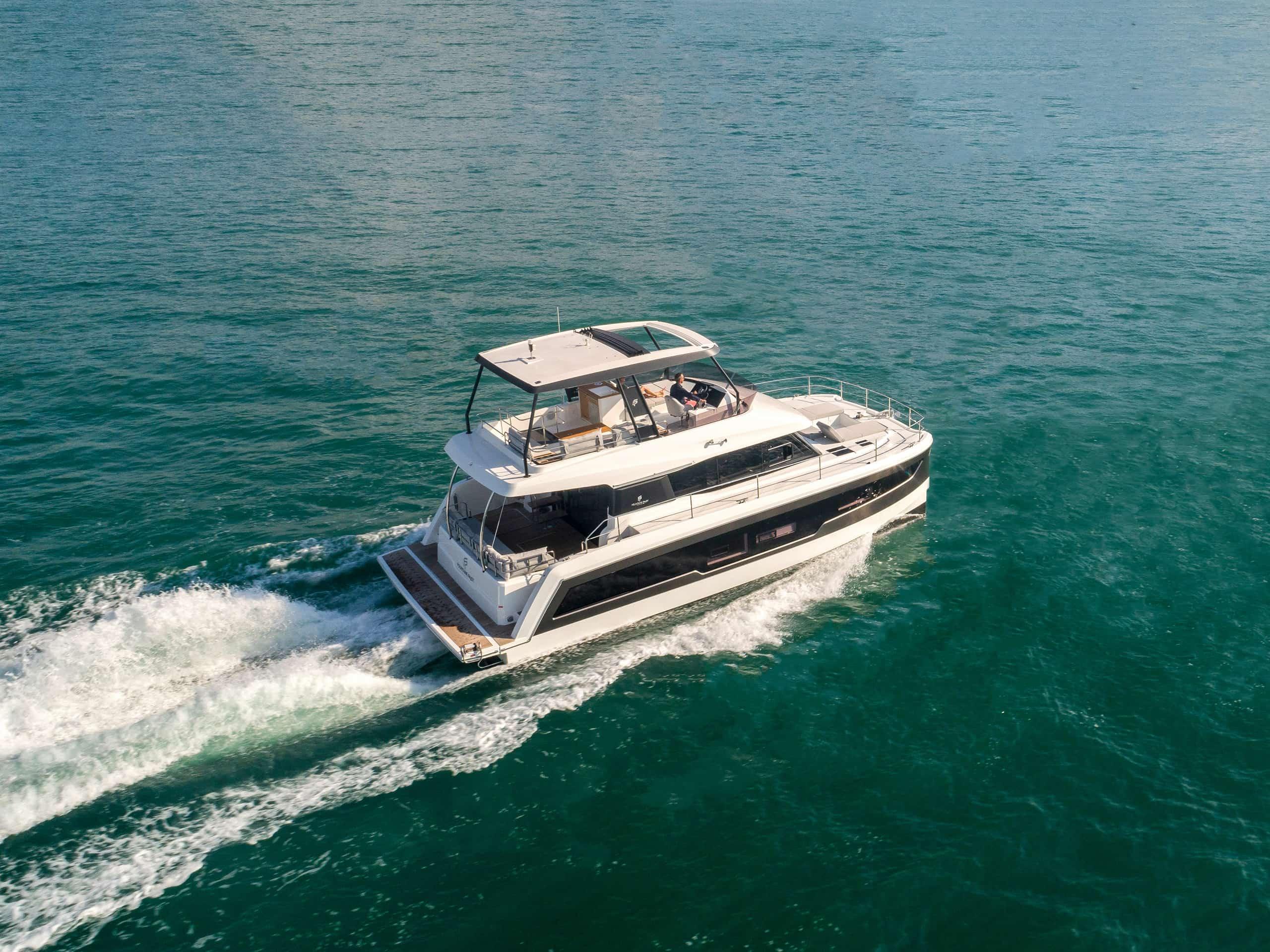 A powered catamaran on an open body of water